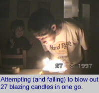 [Attempting (and failing) to blow out 27 blazing candles in one go.]