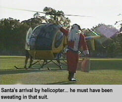 [Santa's arrival by helicopter... he must have been sweating in that suit]