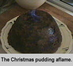 [The Christmas pudding aflame]
