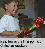 [Isaac learns the finer points of Christmas crackers]