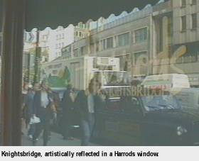 [Knightsbridge, artistically reflected in a Harrods window]