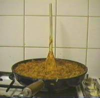 [Bolognaise sauce being cooked]